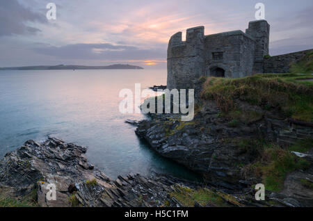 Sunrise over Pendennis Point in Cornwall - Stock Photo