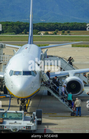 Deboarding passengers at the airport - Stock Photo
