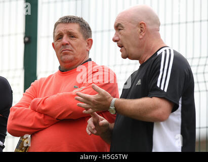 Grays Chief Executive Mike Woodward (L) and team manager Craig Edwards are seen watching trialists play in a friendly - Stock Photo