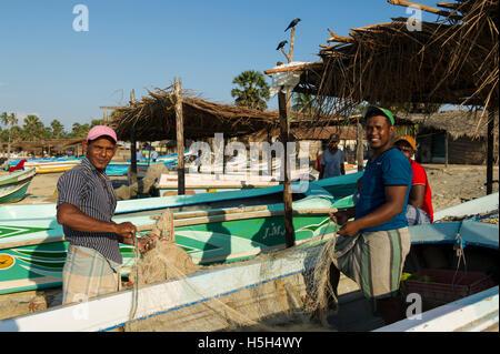 Fishermen fixing nets on the beach, Talaimannar, Mannar Island, Sri Lanka - Stock Photo