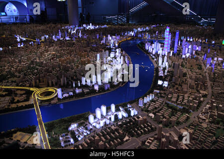 A mini model of the city of Shanghai as it looks in the evening, it is in the Urban Planning Exhibition Hall.  Shanghai, - Stock Photo