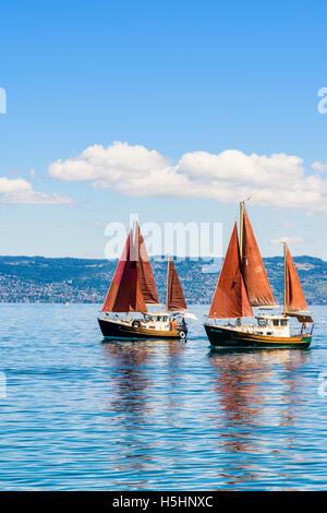 Traditional sailing boats on Lake Geneva, Évian-les-Bains, France - Stock Photo
