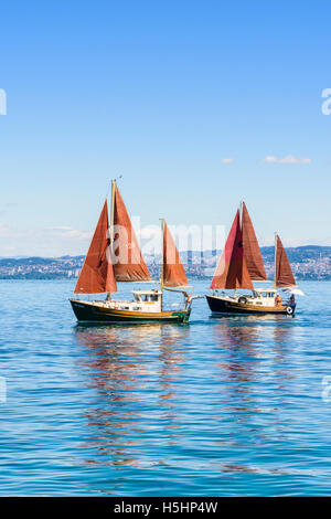 Traditional sailing boats on Lake Geneva, Évian-les-Bains, France - Stock Photo
