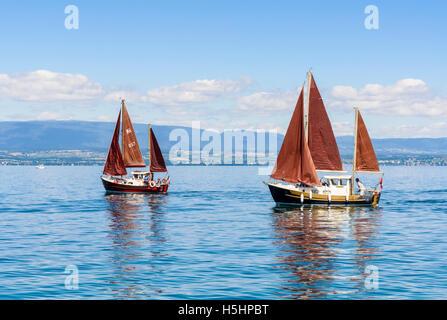 Two traditional sailing boats on Lake Geneva, Évian-les-Bains, France - Stock Photo