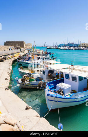 Fishing boats moored in the inner harbour next to the Koules Fortress, Heraklion, Crete, Greece - Stock Photo