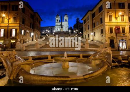 Night view of Fontana della Barcaccia and Spanish Steps, Piazza di Spagna, Rome, Lazio, Italy - Stock Photo