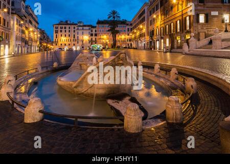 Night view of Fontana della Barcaccia at the foot of Spanish Steps, Rome, Lazio, Italy - Stock Photo