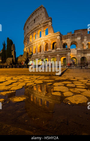 Night view of Colosseum or Coliseum reflected in a puddle, Rome, Lazio, Italy