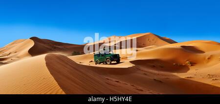 4 x4 Landrover Defnder on the Sahara sand dunes of erg Chebbi, Merzouga Morocco, Africa - Stock Photo