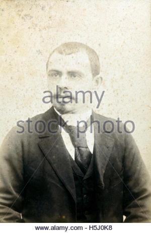 deteriorating studio portrait man late 1800s - Stock Photo