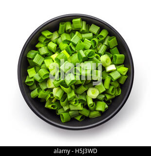 Bowl of chopped spring onions isolated on white background, top view - Stock Photo