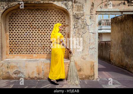 A cleaning woman on duty in Amer Fort, Jaipur, India. - Stock Photo