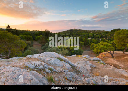 View of Filopappou hill from Areopagus hill, Athens. - Stock Photo