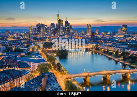 Frankfurt am Main. Image of Frankfurt am Main skyline during twilight blue hour. - Stock Photo