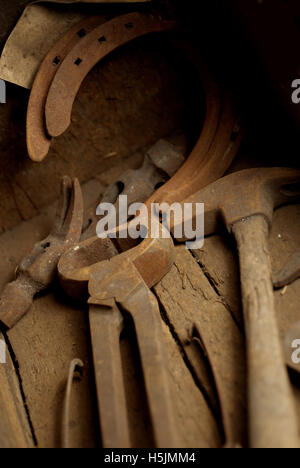 Rusty tools in a wooden box - Stock Photo
