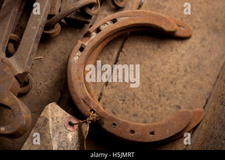 Two rusty horseshoes in a wooden box / Lucky horseshoes - Stock Photo