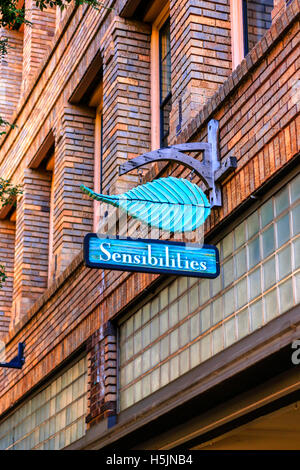 Sensibilies Day Spa overhead sign on Haywood Street in downtown Asheville NC - Stock Photo