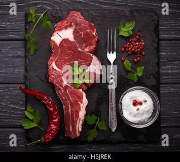 Raw meat steak entrecote. Selective focus - Stock Photo