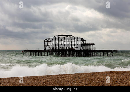 The burned out remains of the West Pier, Brighton, East Sussex, England UK - Stock Photo