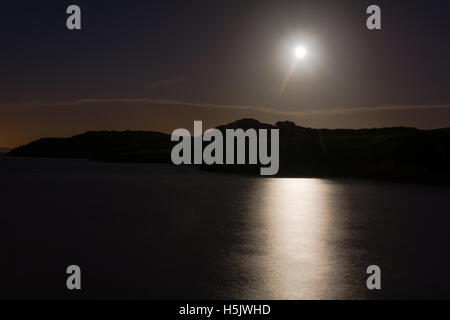 Hunter's moon over sea at Sand Point. Full moon reflected in water of Bristol Channel at high tide, in Somerset, - Stock Photo