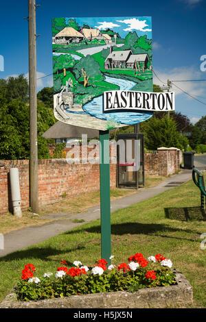 UK, England, Wiltshire, Salisbury Plain, Easterton, village sign and phone box - Stock Photo