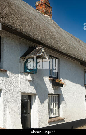 UK, England, Wiltshire, Netheravon, High Street, Clock House, terrace of thatched houses - Stock Photo