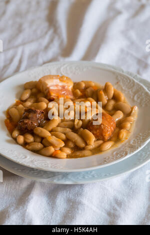 Fabada a typical dish of Spanish cuisine - Stock Photo