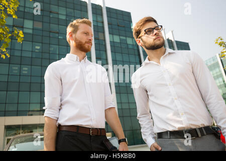 Successful business people outdoors going home - Stock Photo