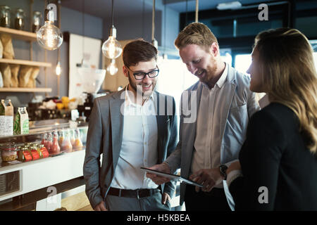 Colleagues hanging out in cafe after work - Stock Photo