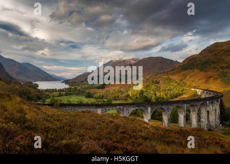 Autumn colours in the mountains overlooking the Glenfinnan viaduct and Loch Shiel, Scottish Highlands, UK - Stock Photo