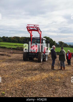 Spectators and a tractor at Ashover Plouging Match, held at Highoredish Farm, Derbyshire - Stock Photo