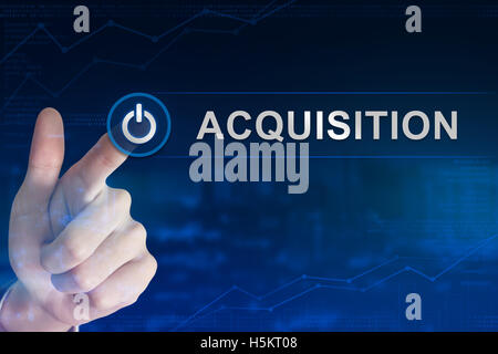 double exposure business hand clicking acquisition button with blurred background - Stock Photo