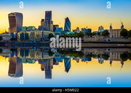London cityscape at sunset with reflection from river Thames - Stock Photo