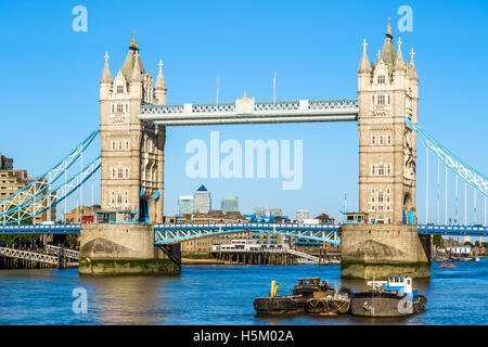 Tower Bridge in London with Canary Wharf district at the background - Stock Photo