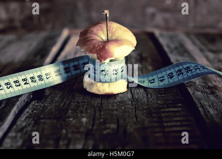 anorexia thinness measuring apple - Stock Photo