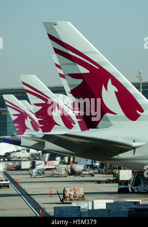 tails of Qatar airplanes Hamad Doha international airport - Stock Photo