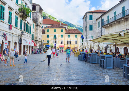 The Square of Arms is one of the most busy places in old town, tourists visit cafes and bars - Stock Photo