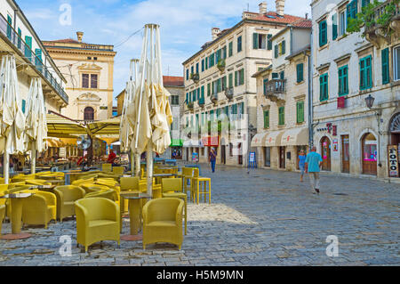 The cafes and restaurants on the Main Square are empty in the early morning - Stock Photo