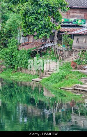 Old run down River shacks in Phetchaburi, Thailand. - Stock Photo