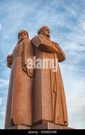 The red riflemen of Riga monument that commemorates Lenin's private Latvian bodyguards. - Stock Photo