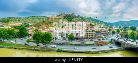 The panoramic view of Sololaki Hill with Narikala Fortress and the old town located, on its slopes, Tbilisi Georgia - Stock Photo