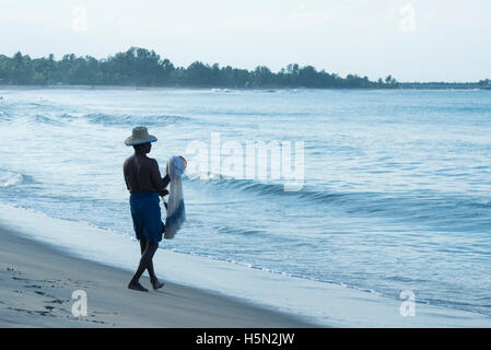 Traditional fisherman with a net, Arugam Bay, Sri Lanka - Stock Photo
