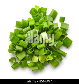 Heap of chopped spring onions isolated on white background, top view - Stock Photo