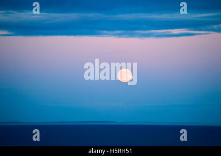 Full moon rising over the San Juan Islands, photographed from Victoria, British Columbia, Canada - Stock Photo
