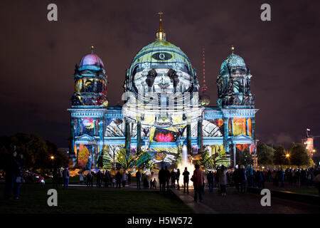 Berliner Dome illuminated by colorful images during the world famous Festival of Lights. - Stock Photo
