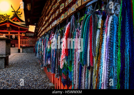 Origami cranes and prayer tablets at Fushimi Inari Shrine in Kyoto, Japan. - Stock Photo