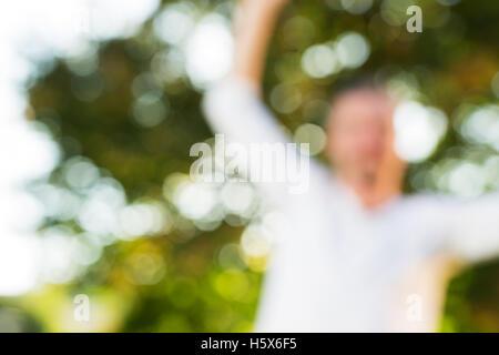 man practicing slackline, balancing on slack - out of focus - Stock Photo