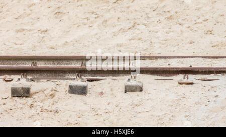 Desert railroad track - The desert is taking over - Stock Photo