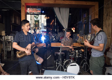 Poetry Jazz Cafe in Kensington Market. Band of musicians performing. Kensington Market is a distinctive multicultural - Stock Photo