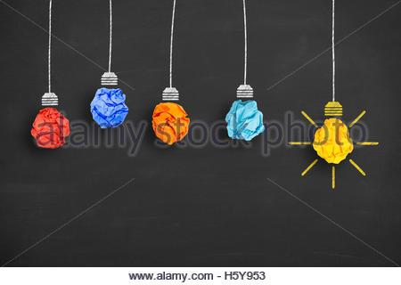 Crumpled Paper Light Bulb Idea Concept on Blackboard - Stock Photo